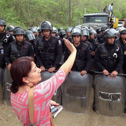 A woman protests mining in Guatemala