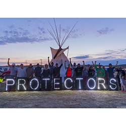 """Protectors"" #noDAPL message. Photo credit: Joe Brusky, Overpass Light Brigade"