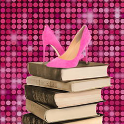 A pair of pink high-heels sits atop a stack of large textbooks