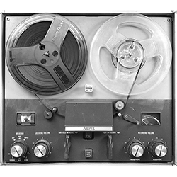 Image of anachronistic reel-to-reel tape player, shown in black & white
